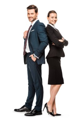 successful young business partners leaning back to back and looking at camera isolated on white