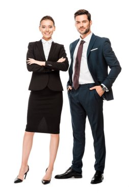 attractive young business partners in stylish suits looking at camera isolated on white