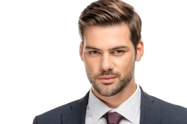 close-up portrait of handsome young businessman in jacket looking at camera isolated on white