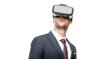young businessman using virtual reality headset isolated on white