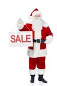 Fotografie Happy santa Clause holding prodej desky izolované na bílém