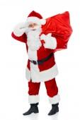 Fotografie Santa claus v červený kostým s vánoční taška při pohledu odtud izolované na bílém