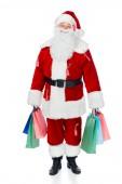 boldog Mikulás piros ruha eladó címkék gazdaság bevásárló táskák elszigetelt fehér