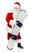 Fotografie Santa claus stojící s snowboard izolované na bílém