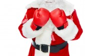 Fotografie cropped view of santa claus in boxing gloves and red costume with sale tags isolated on white