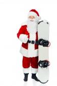 Weihnachtsmann mit Snowboard zeigt Daumen nach oben vereinzelt auf weiß