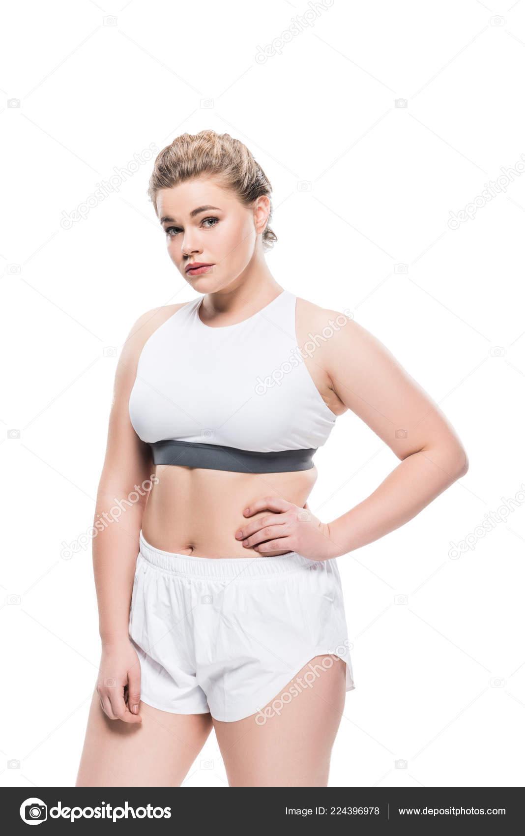 48ae222d202e Νεαρή Γυναίκα Υπέρβαροι Αθλητικά Ενδύματα Στέκεται Χέρι Στην Μέση Και — Φωτογραφία  Αρχείου