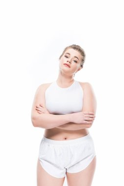 Young overweight woman in sportswear standing with crossed arms and looking at camera isolated on white stock vector