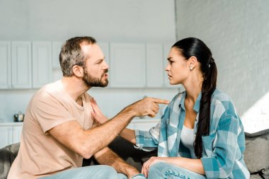 Couple having argument and husband yelling at tired wife stock vector