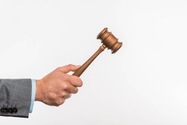 cropped shot of judge holding wooden hammer in hand isolated on white