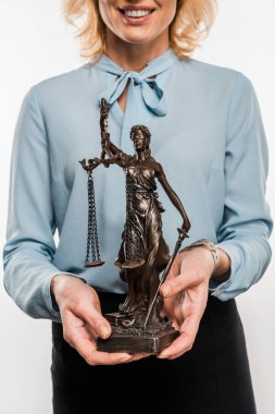 cropped shot of smiling female lawyer holding lady justice statue isolated on white