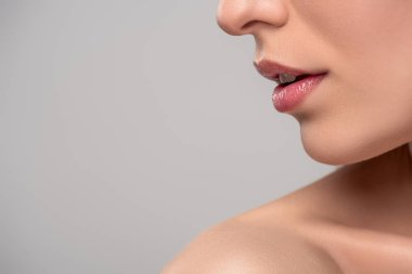 cropped view of woman with beautiful lips and perfect skin, isolated on grey