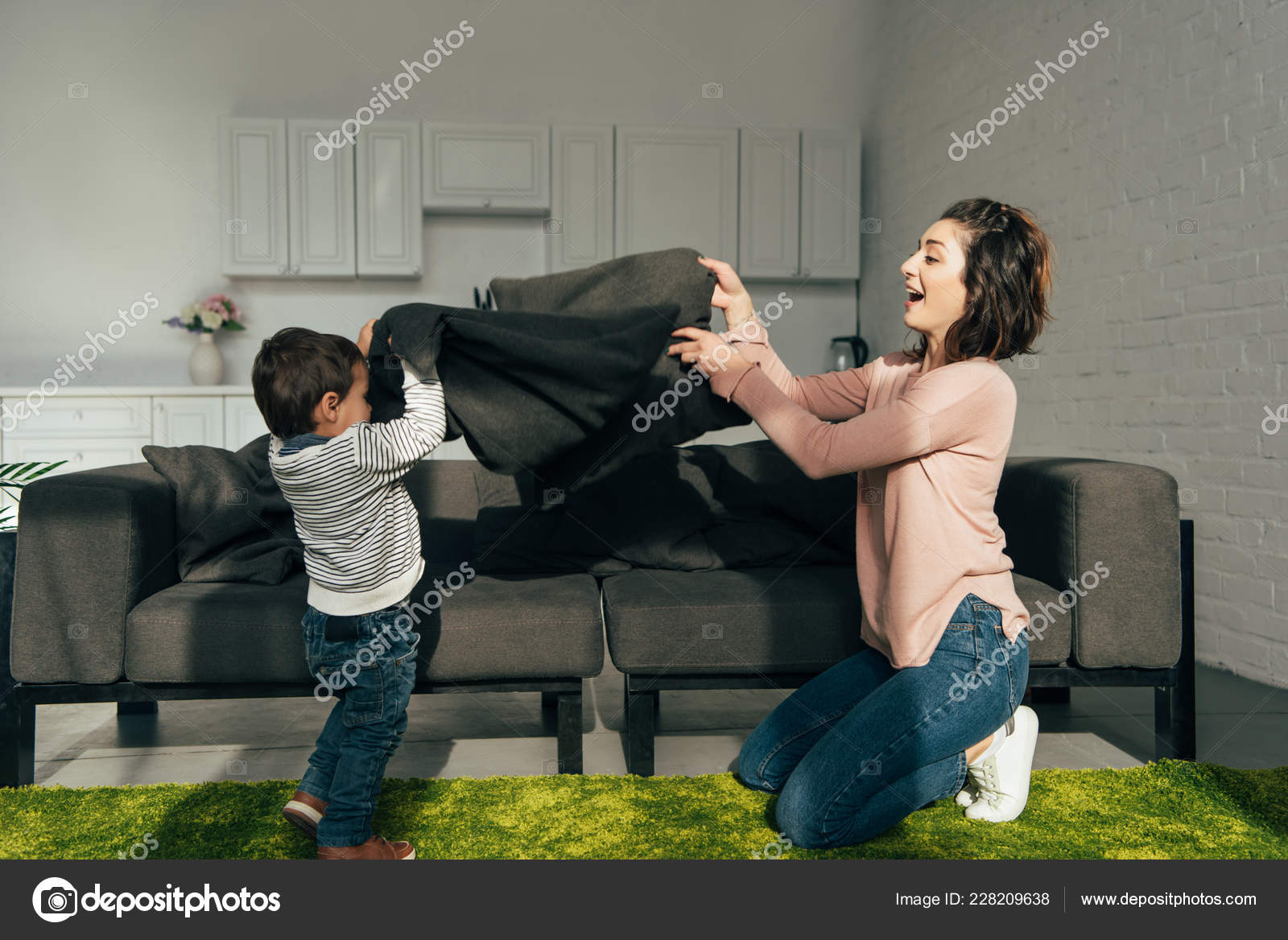 Free Spreading Pics side view mother son spreading blanket sofa living room