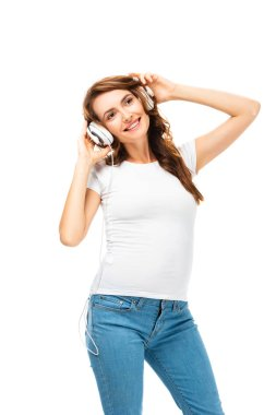 pregnant woman listening music with headphones isolated on white