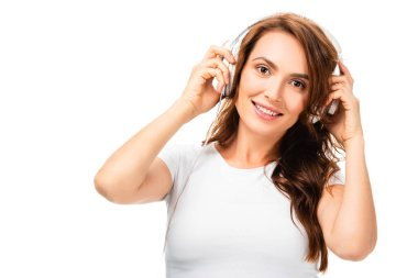 beautiful woman listening music, using headphones and looking at camera isolated on white