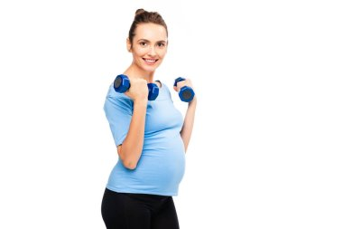 pretty pregnant woman holding dumbbells isolated on white