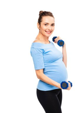 pregnant brown haired woman holding dumbbells isolated on white