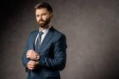 Fotografie successful bearded businessman standing in formalwear