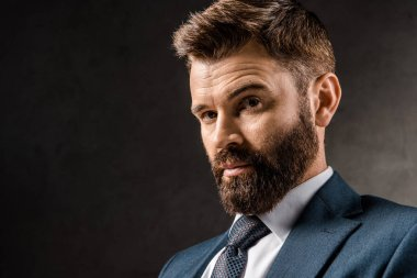 close up of handsome bearded businessman in formalwear