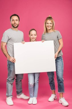 Beautiful family posing with blank placard, isolated on pink stock vector