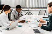 group of multiethnic businesspeople having discussion during meeting in office