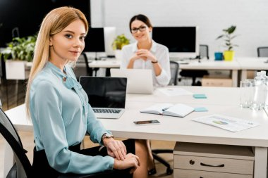 businesswomen at workplace with laptops in office