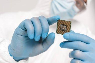 selective focus of microprocessor in hands of scientist