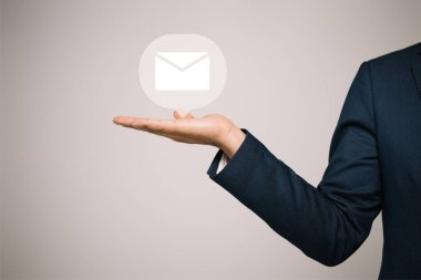 Partial view of businessman in suit gesturing and presenting email icon isolated on grey stock vector