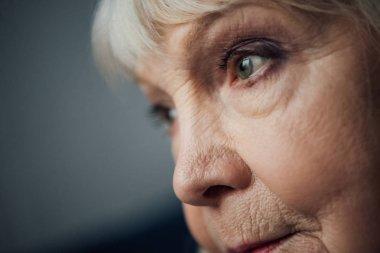 close up of sad senior woman looking away