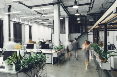 contemporary office interior with blurred businesspeople in motion