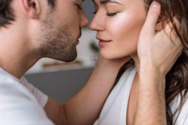 close up of attractive woman and sensual man with closed eyes