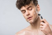 handsome man with razor after bad shaving, isolated on grey