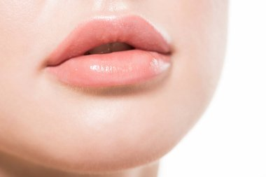close-up view of beautiful female lips and face with perfect skin isolated on white
