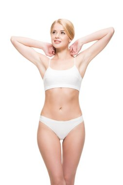 Attractive smiling slim girl in white underwear looking away isolated on white stock vector