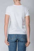 Photo back view of woman posing in white t-shirt with copy space, isolated on grey