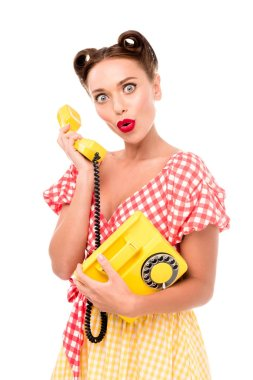 Surprised pin up girl talking on vintage yellow phone stock vector