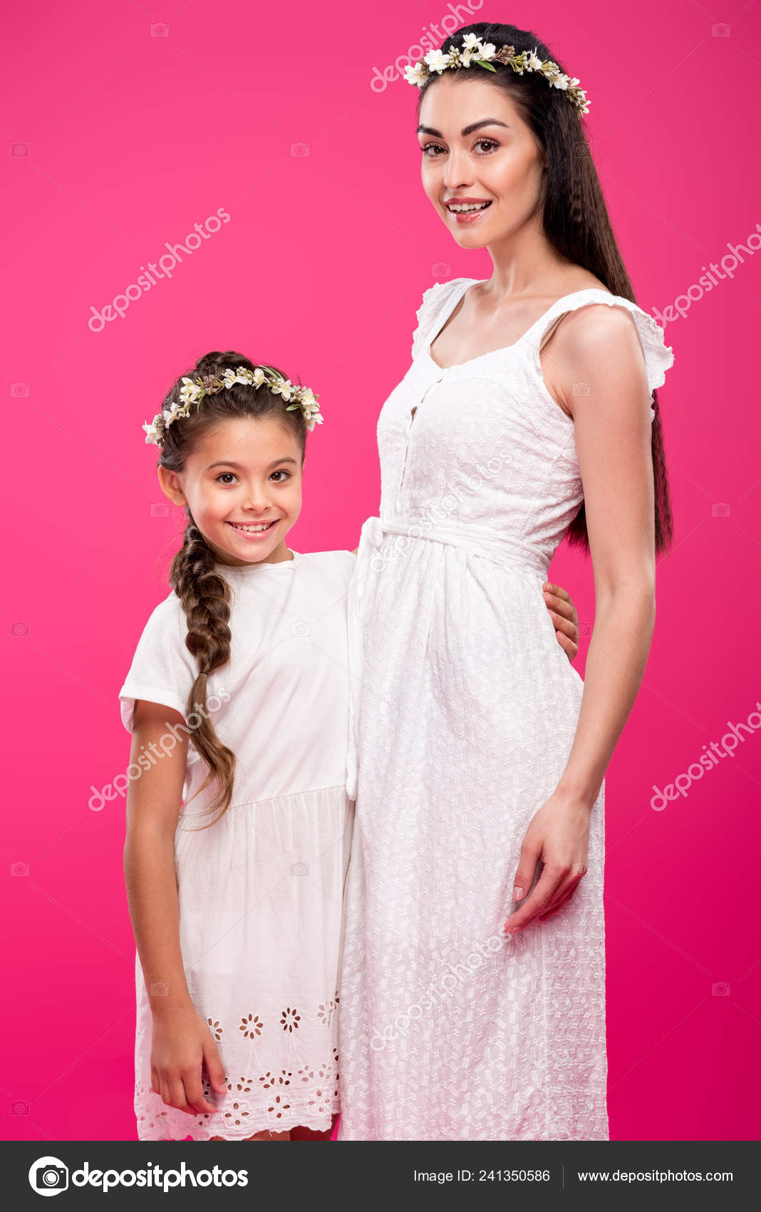 ae4eec2aed Beautiful happy mother and daughter in white dresses and floral wreaths  hugging and smiling at camera isolated on pink — Photo by ...