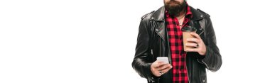 Cropped view of man in black leather jacket holding coffee to go and using smartphone, isolated on white stock vector