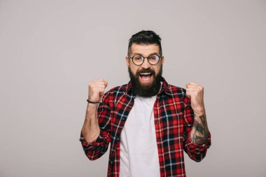 excited bearded man in checkered shirt, isolated on grey