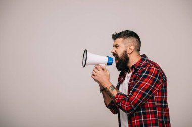 angry bearded man in checkered shirt shouting into megaphone, isolated on grey
