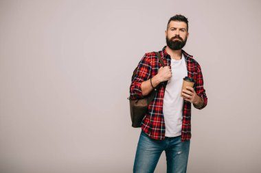 Bearded man in checkered shirt with backpack holding coffee to go isolated on grey stock vector