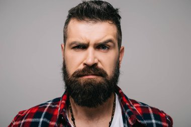 stylish bearded man in checkered shirt thinking isolated on grey