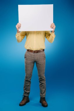 Man holding blank placard isolated on blue stock vector