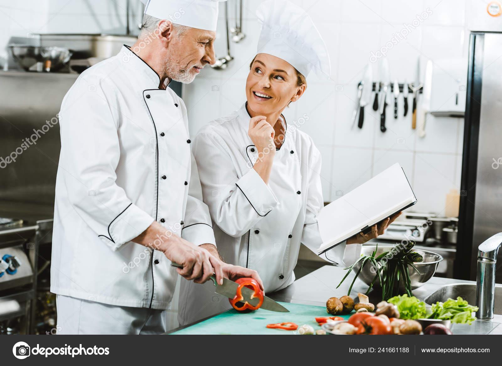 Female Male Chefs Uniform Using Recipe Book Cooking Restaurant