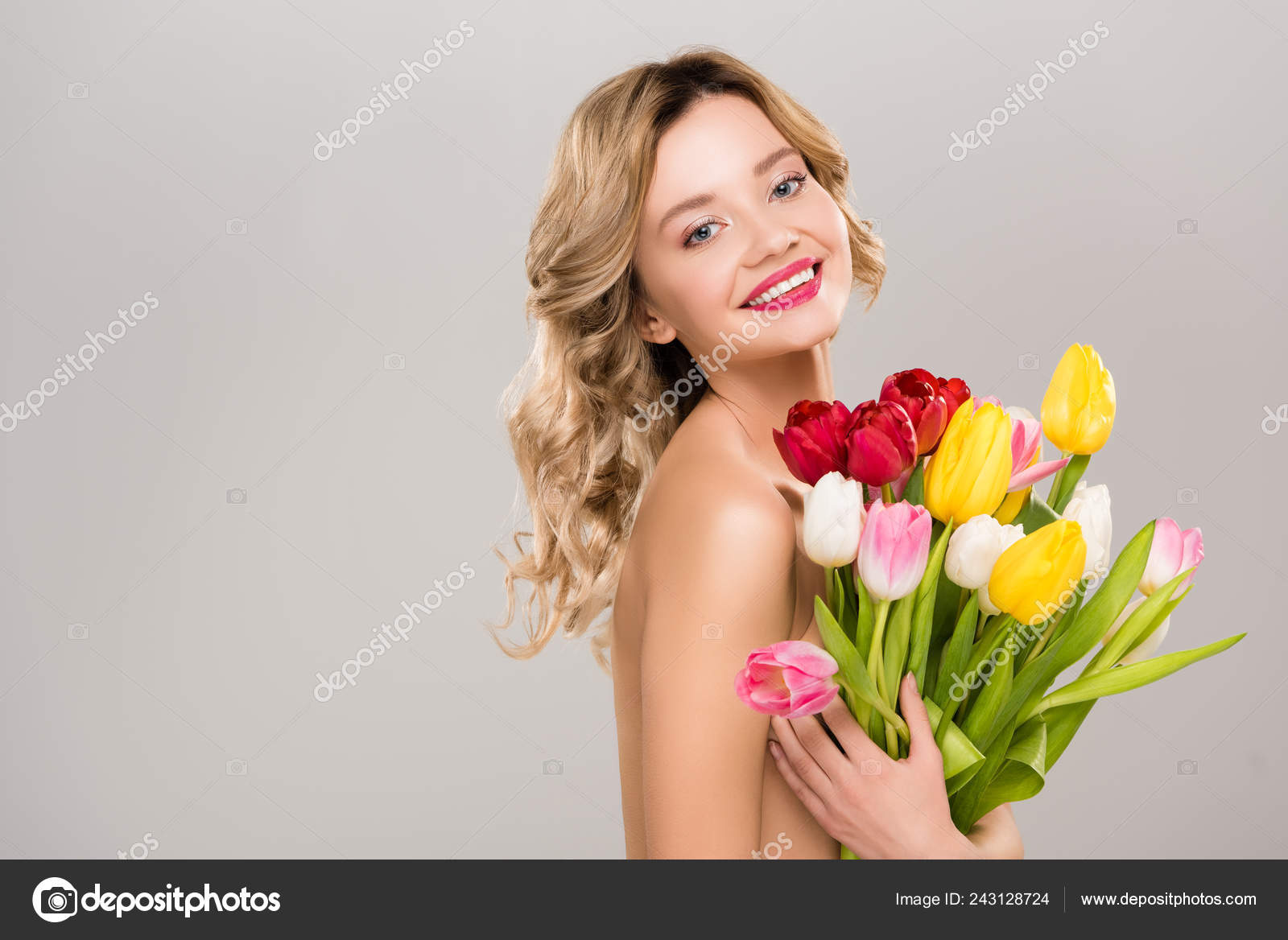 Beautiful naked girl on the tulip flower exact