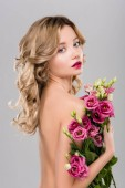 spring naked beautiful blonde woman posing with Eustoma flowers bouquet isolated on grey