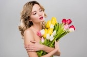 Fotografie young attractive spring woman holding bouquet of multicolored tulips isolated on grey