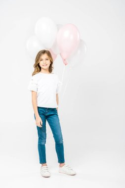 Cute child in white t-shirt and blue jeans holding festive air balloons on white background stock vector