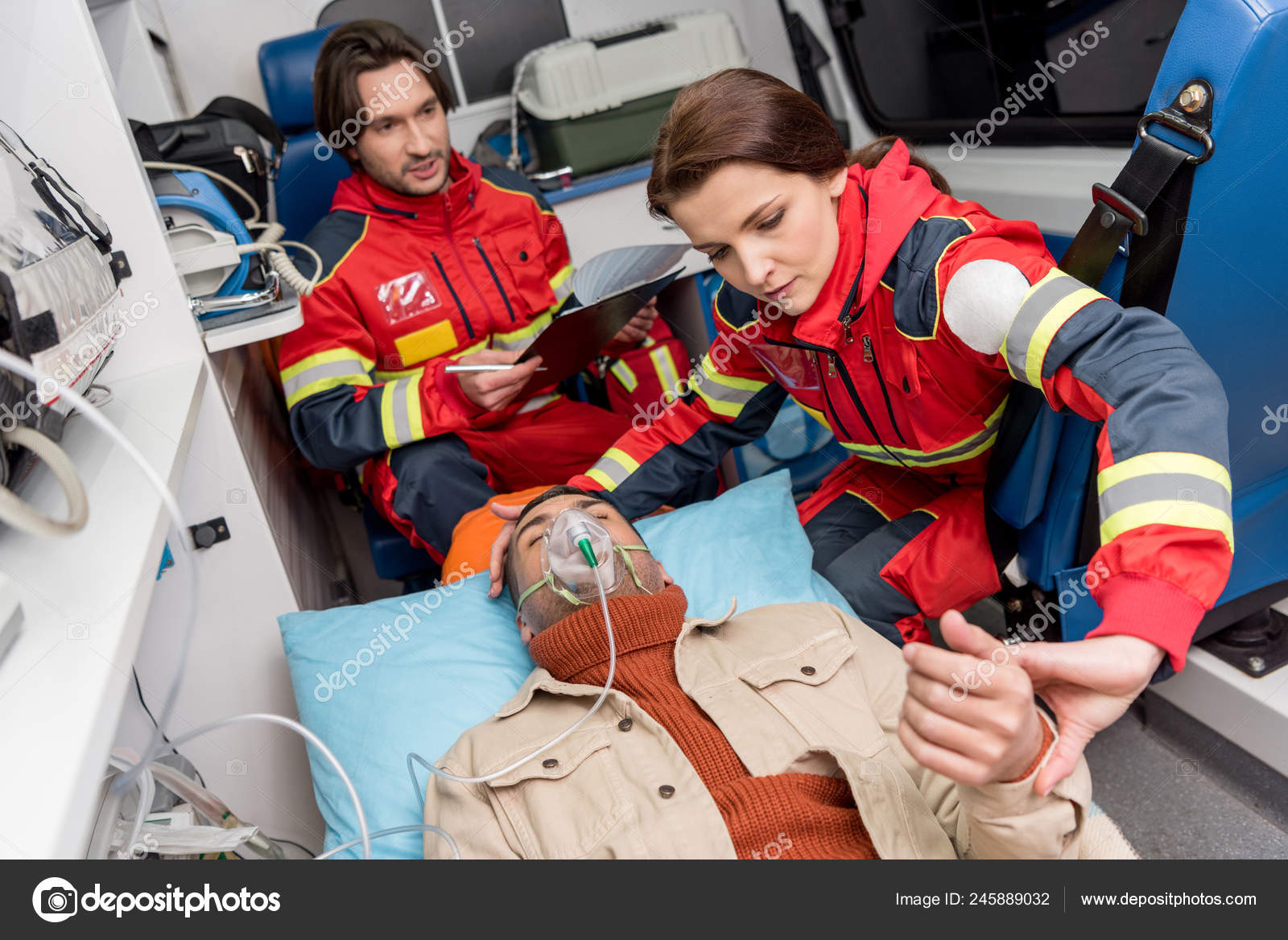Paramedic Holding Oxygen Mask Patient Checking Pulse — Stock Photo