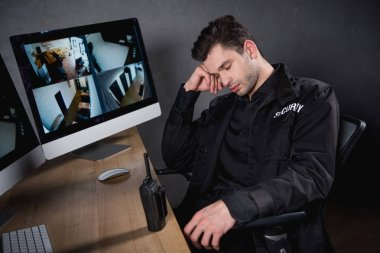 handsome guard in uniform sleeping at workplace